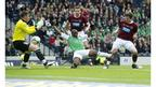 Defender Darren Barr (right) pounces on the ball to open the scoring for Hearts from close-range