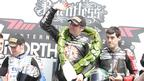 Michael Rutter on top of the podium for a 13th time at the North West 200 after winning the Superstock race