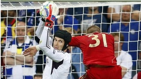 Chelsea's goalkeeper Petr Cech saves in front of Bayern Munich's Bastian Schweinsteiger
