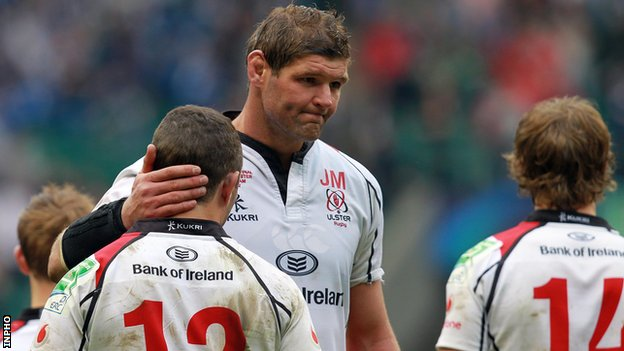 Ulster captain Johann Muller consoles Paddy Wallace after Saturday's final