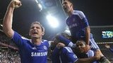 Chelsea players, including Frank Lampard (left) celebrate