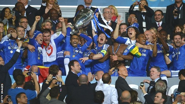 Chelsea players celebrate with the Champions League trophy