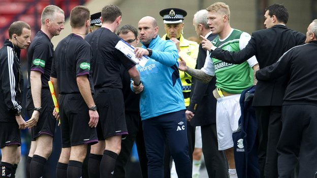 Hibs players and management confront the officials at the final whistle