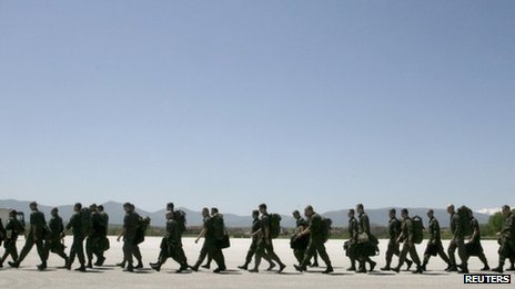 Nato peacekeepers from Austria march together after arriving at Djakovica Airport in Kosovo, April 27, 2012.