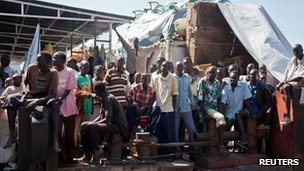South Sudanese returnees from Khartoum arrive at the port in South Sudan's capital Juba May 16, 2012.