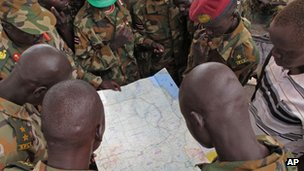 Soldiers from South Sudan examine a map at the frontline position in Pana Kuach, Unity State May 11 2012.
