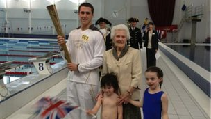 Jordan Anderton with torch fans old and young