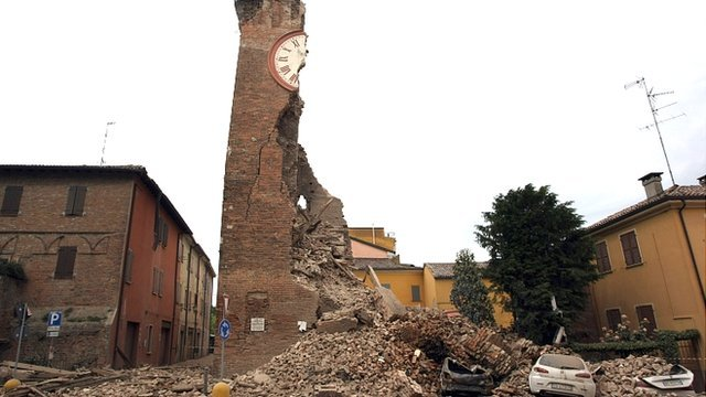 Damaged tower and cars