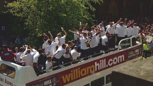 Heart of Midlothian team members on an open-top bus