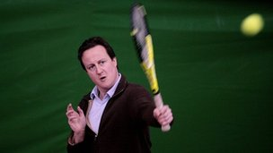 David Cameron playing tennis