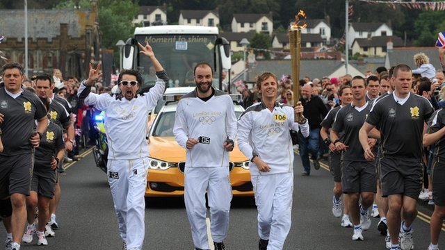 Muse with the Olympic torch
