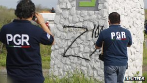 Police officers photograph a sprayed Z in Cadereyta