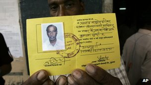 A fisherman holds an identity card in Mumbai