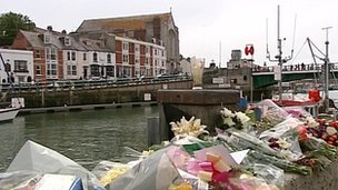 Floral tributes on Weymouth's quayside