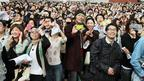 People in Osaka, western Japan, watch eclipse