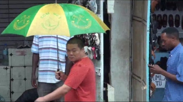 A Chinese man in one of Tanzania's markets