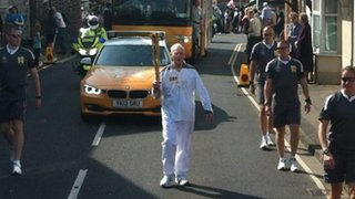 Arthur Gilbert, 91, with the torch