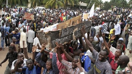 Protesters holding a coffin for the transitional president