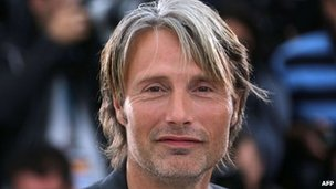 "Danish actor Mads Mikkelsen poses during the photocall of ""Jagten"" (The Hunt)"