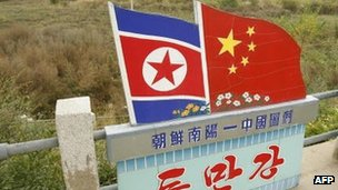 Chinese and North Korean National flags on the Chinese/North Korean border in the town of Tu Men in China's northeast Jilin province 12 October 2006