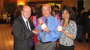 Derek Peaple and Rekha Slatter with the London 2012 Olympic medals