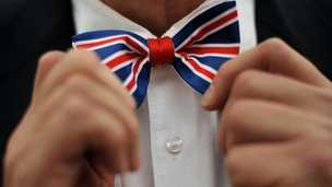 Man adjusting Union jack bow tie