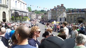 Crowds in Frome await the torch
