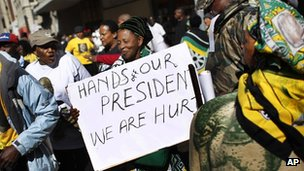 Supporters of South African President Jacob Zuma gather outside the South Gauteng High Court in Johannesburg, South Africa, Tuesday 22 May 2012