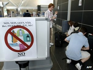 Airport sign prohibiting liquids in luggage