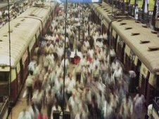 Thousands of commuters alight from trains enroute to work in Mumbai
