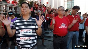 Supporters of Mr Corona attend an interfaith prayer session for him at the  Supreme Court in Manila on Tuesday