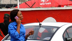 A woman on a mobile phone in Abuja, Nigeria