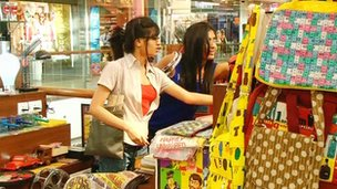 Young Indian ladies shooping in a Happily Unmarried store