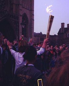The torch is held aloft in Bristol
