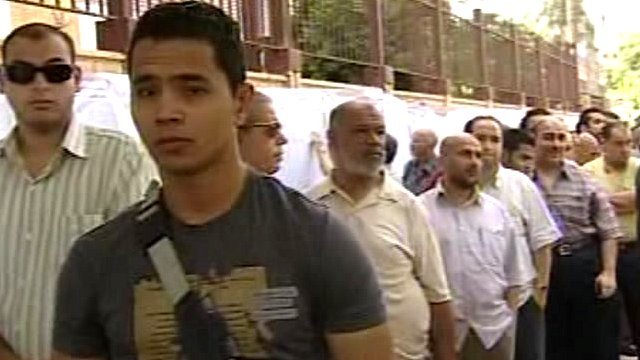 Men waiting to vote in Cairo