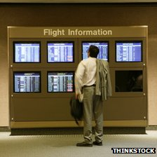 Man looking at flight information