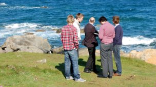 Students on Guernsey's coast