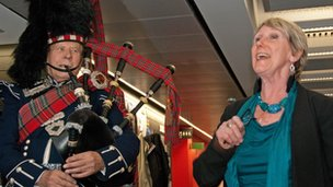 Mary Kalemkerian with bagpipe player