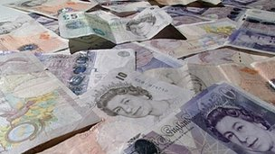 Pile of British money notes.