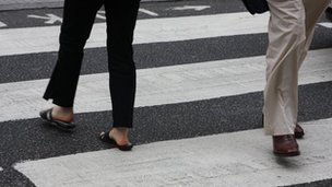 Pedestrians cross zebra crossing