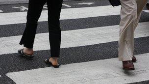 Pedestrians cross zebra crossing