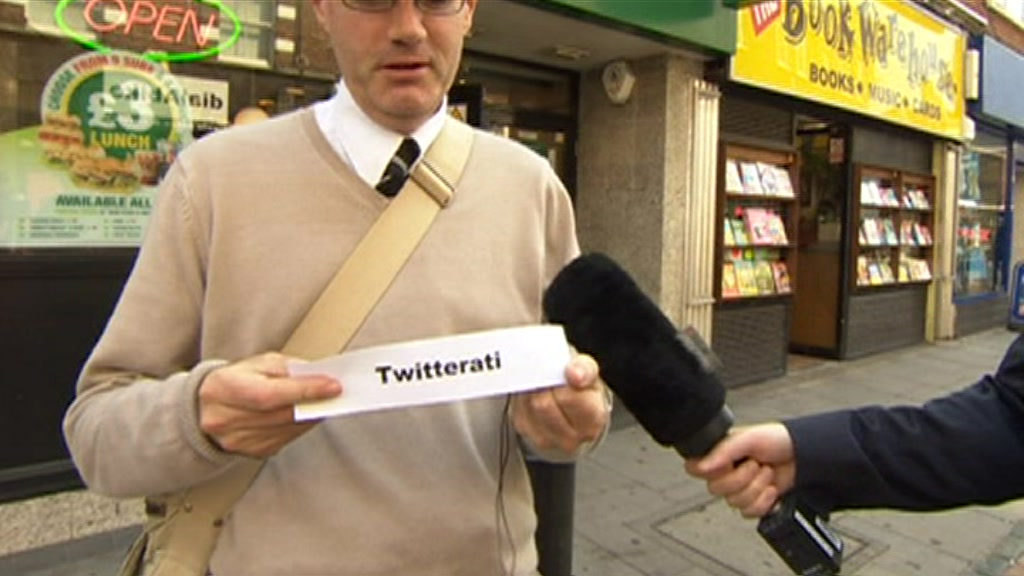 Man holding paper with word &#039;twitterati&#039;