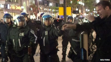 Police use pepper spray on a protester in Montreal on 22 May 2012