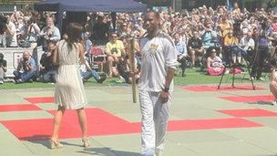 Didier Drogba gets ready for his run with the torch