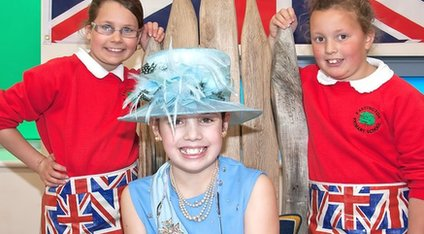 Children from Eastington Primary School celebrate their win in 'royal' fancy dress.