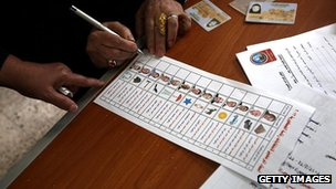 Voter looks at her ballot before casting her vote in Egypt's presidential election on 23 May 2012