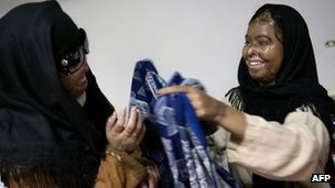 Acid attack survivors Naila Farhat and Naziran Bibi at the Al-Shifa trust eye hospital in Rawalpindi, Pakistan, in December 2009