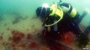 A diver inspects the wreck
