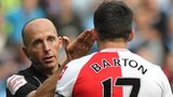 QPR midfielder Joey Barton is sent off by referee Mike Dean