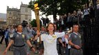 Margaret Glastonbury carrying the Olympic flame on the leg between Bristol and Nailsea